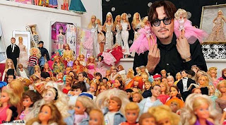 Johnny Depp With His Barbie Collection
