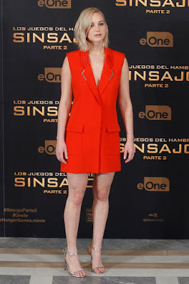 Jennifer Lawrence goes braless in plunging red tuxedo dress