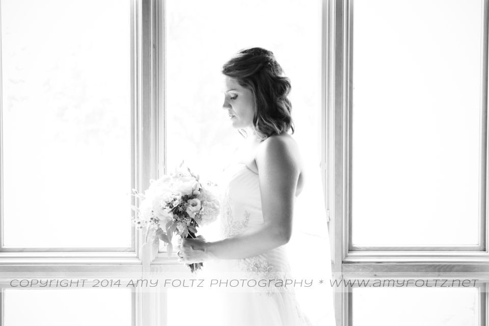 portrait of bride in front of window