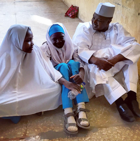 News : Kebbi governor sits on bare floor with students after fire incident at their school [ Photo ]