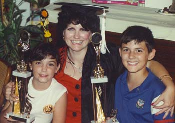 Barbara Truman giving her children trophies for their support