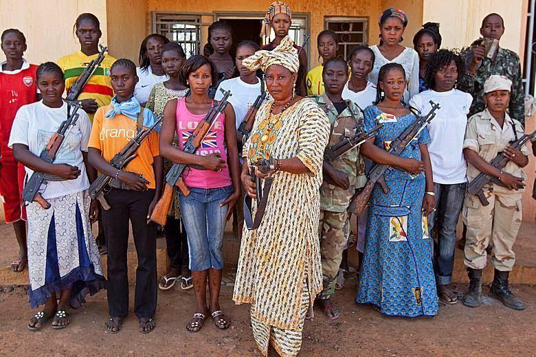 Photo of a group of Nigerian women holding assault rifles.