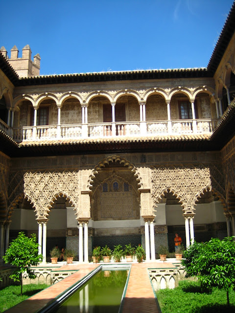Courtyard in The Alcazar, or Royal Palace in Seville, Spain.