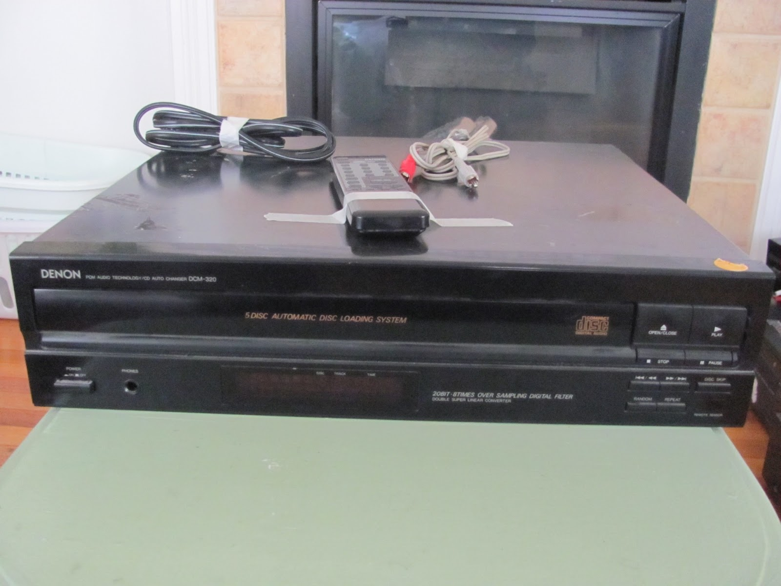 Denon 5-Disc CD changer on display before being sold on Craigslist