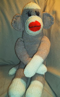 http://www.thepatternbox.com/assets/sockless_sock_monkey.pdf