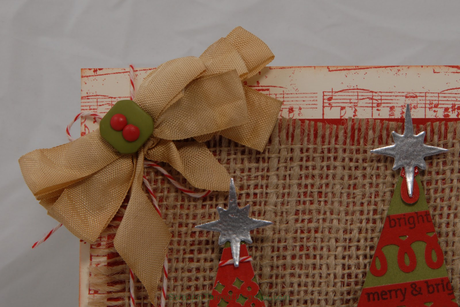 Paper and fiber arts country christmas card with edge punch garland