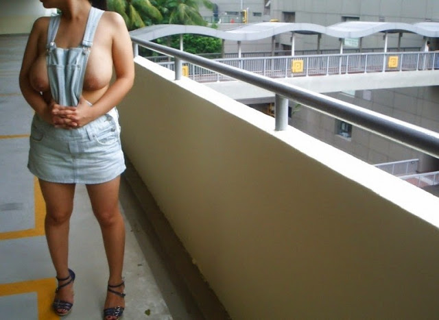 Bra-less Chinese MILF Flashes Her 38DD Boobs At Carpark
