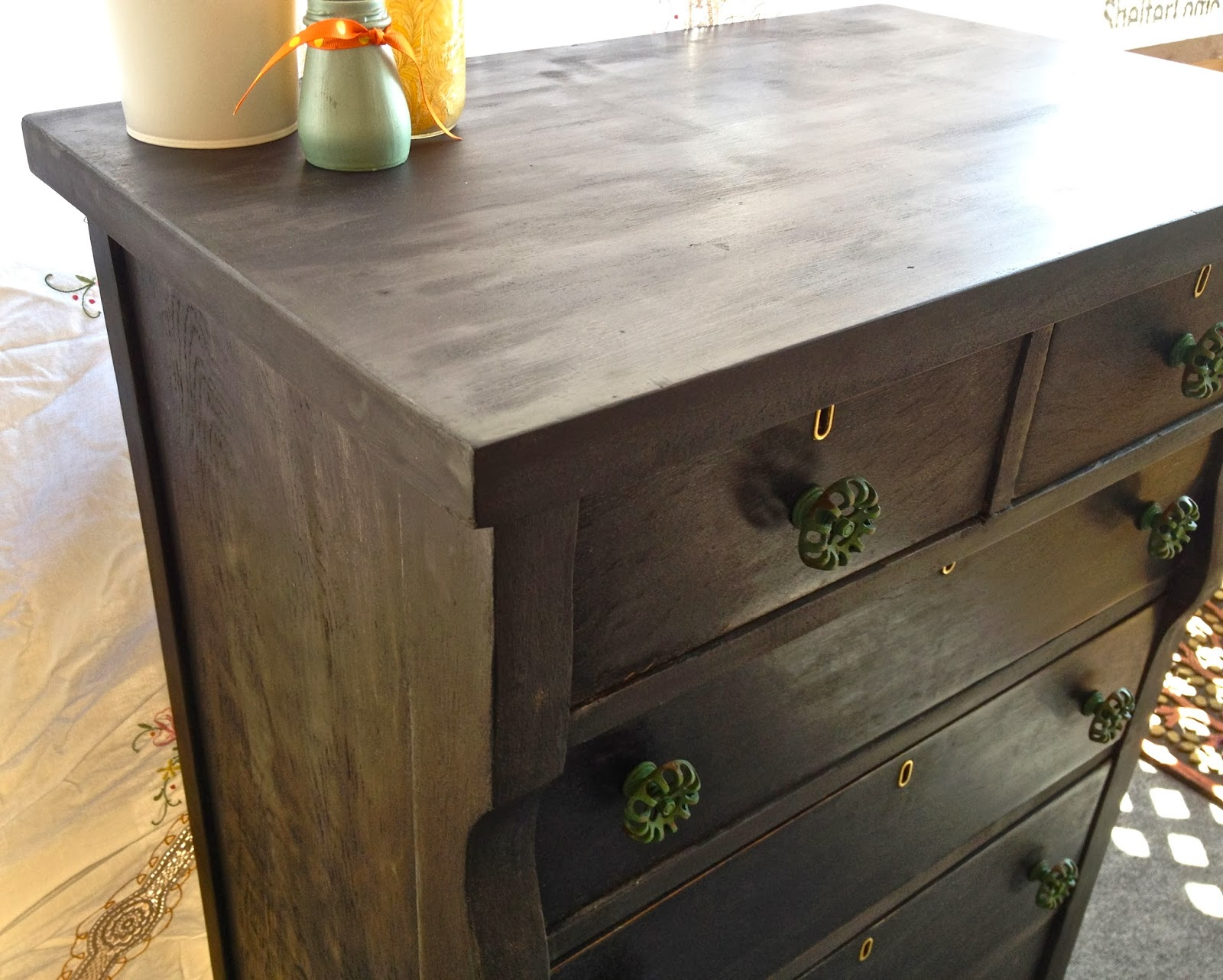 black antique dresser with green knobs hemp oil