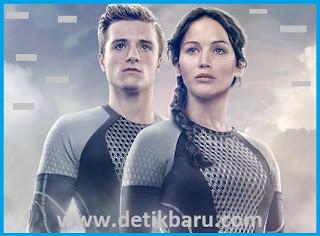Katniss Everdeen (Jennifer Lawrence) dan Peeta Mallark (Josh Hutcherson)