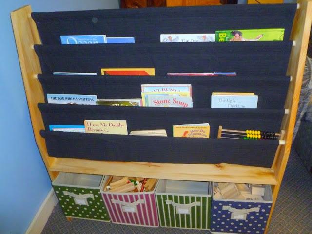 born imaginative sling bookshelf with storage bins for kids. Black Bedroom Furniture Sets. Home Design Ideas