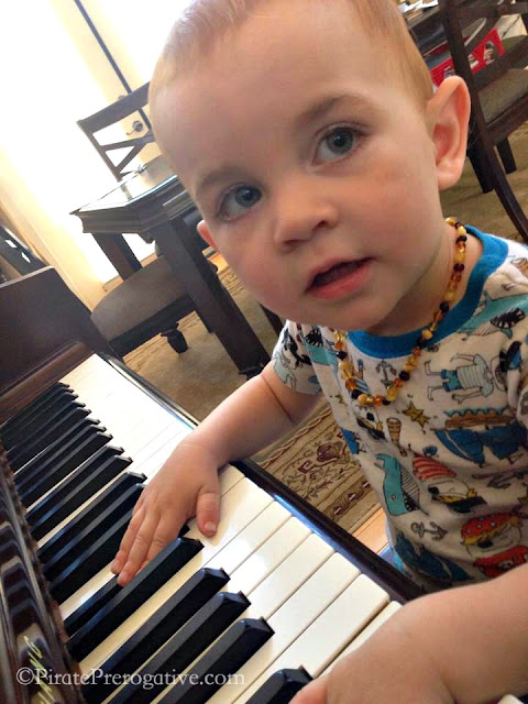 Musical toddler playing the piano.