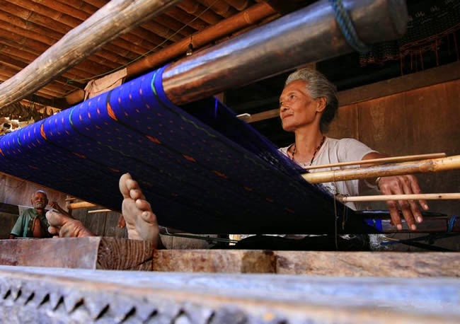 Weaving is the famous traditional home industry to produce woven fabrics called 'Tenun Ikat'.  Bena Village, Flores, East Nusa Tenggara, Indonesia