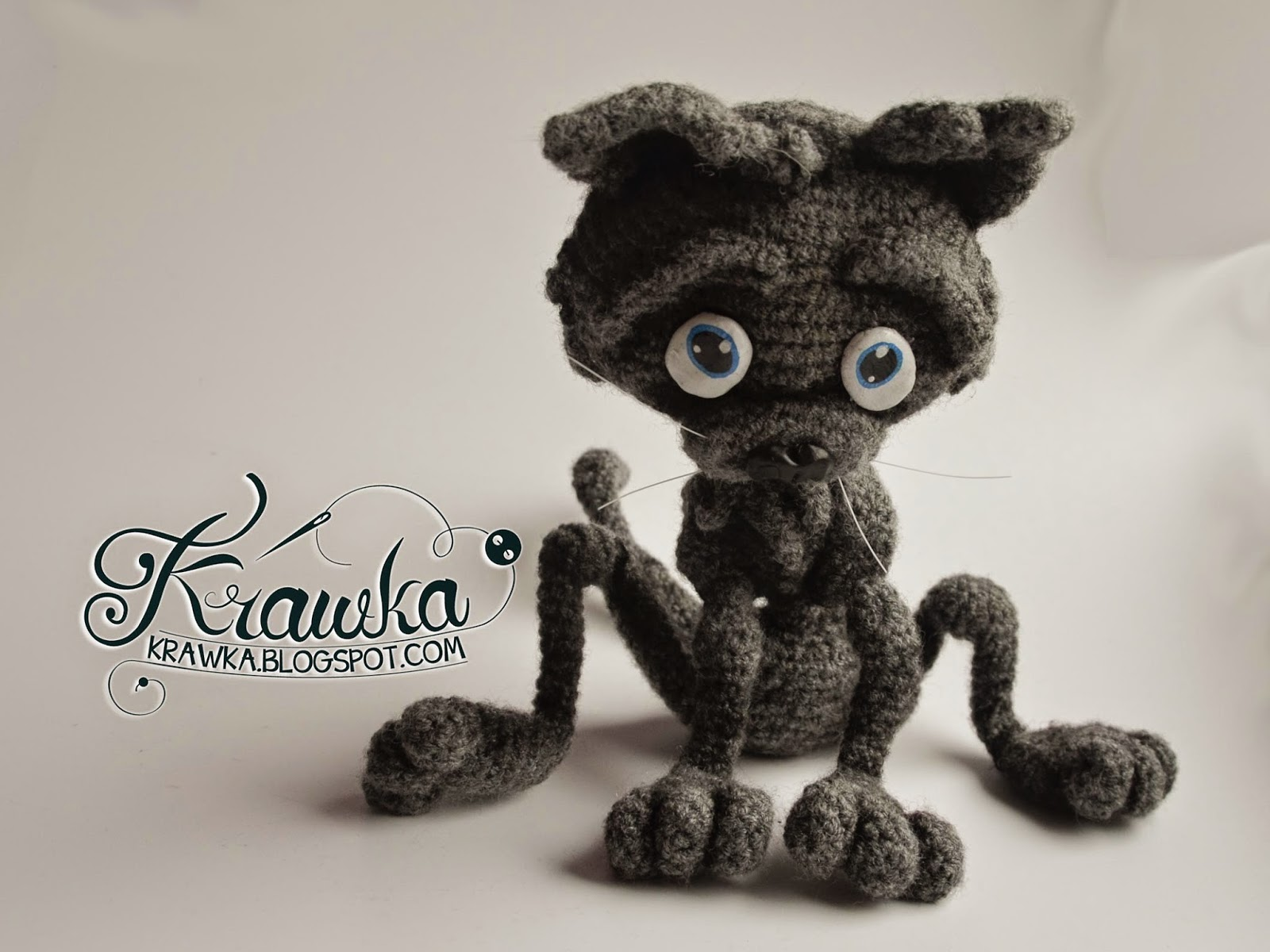 Krawka: Crochet smelly cat, wires inside, eyes and nose made from modeling clay