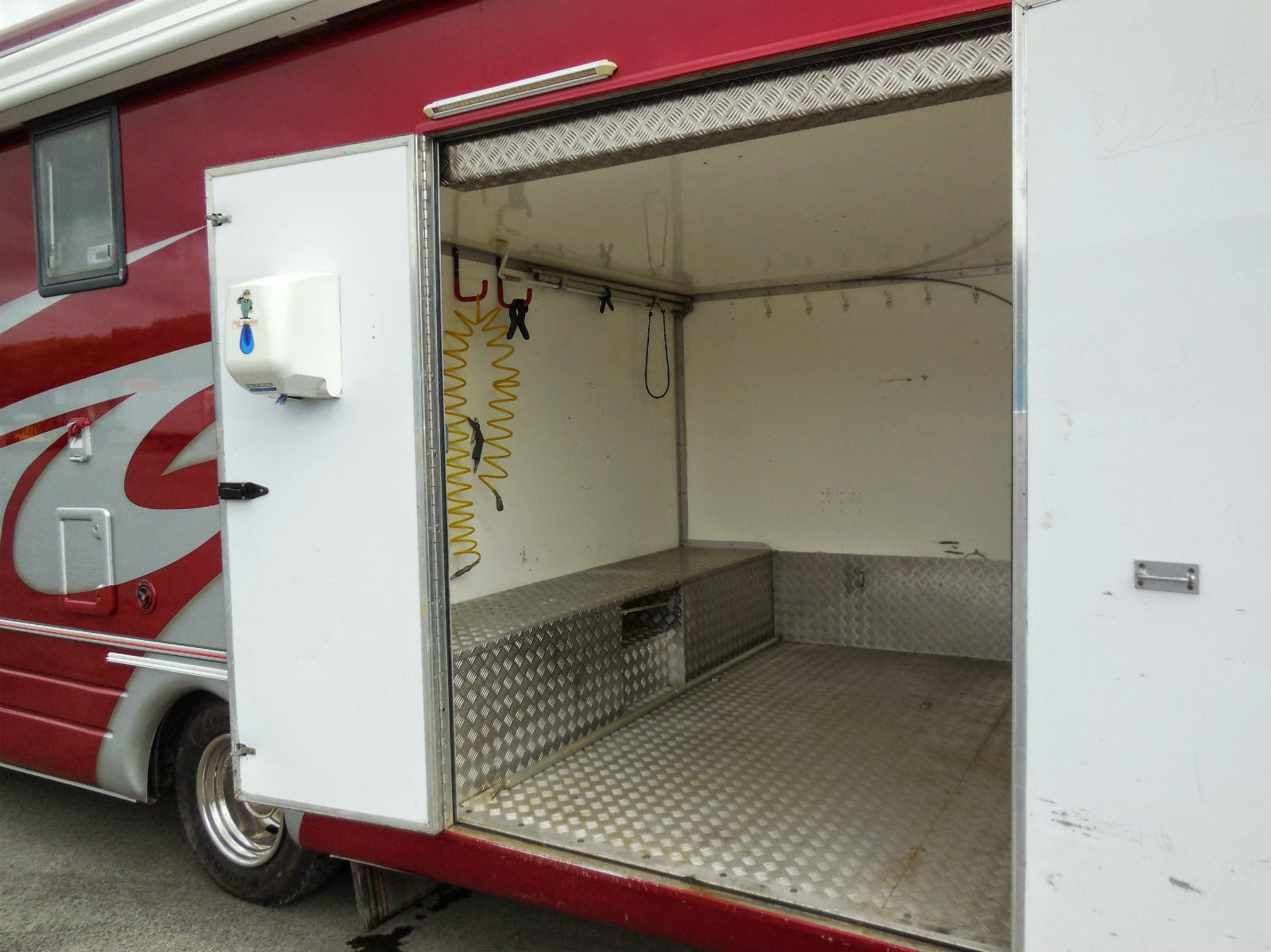 Used rvs krm race motorhome for sale for sale by owner for Rv with car garage for sale