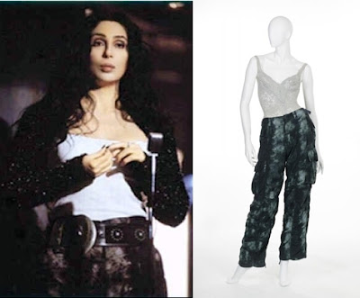 a still from behind-the-scenes of Cher's 1998 'Believe' music video - and the outfit from it