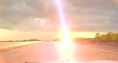 Lightning strike captured by police dash cam