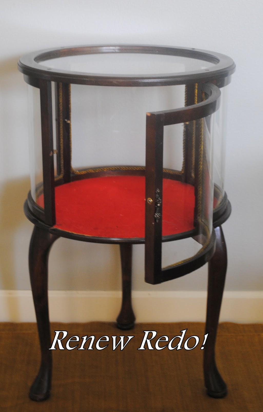 Fancy  the thing was meant to be filled with stuff maybe not liquor but Anyway here us the find a little antique curio cabinet end table