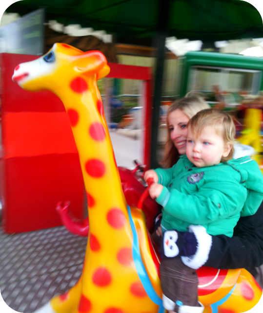 first time on merry go round, london zoo, one year old on merry go round