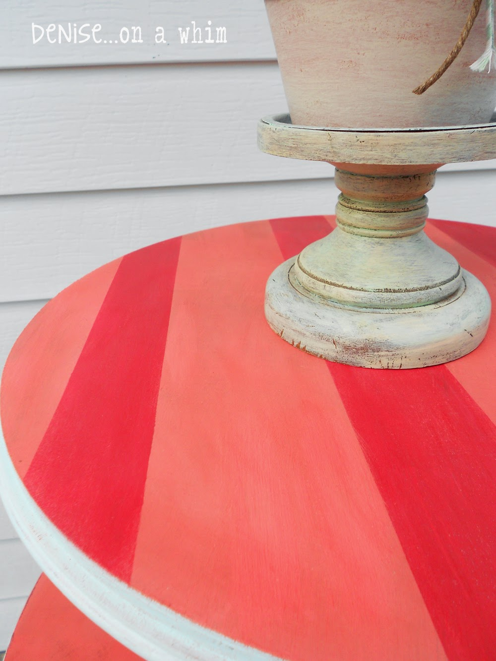 Coral with red stripes add a touch of whimsy to a roadside rescue table from Denise on a Whim