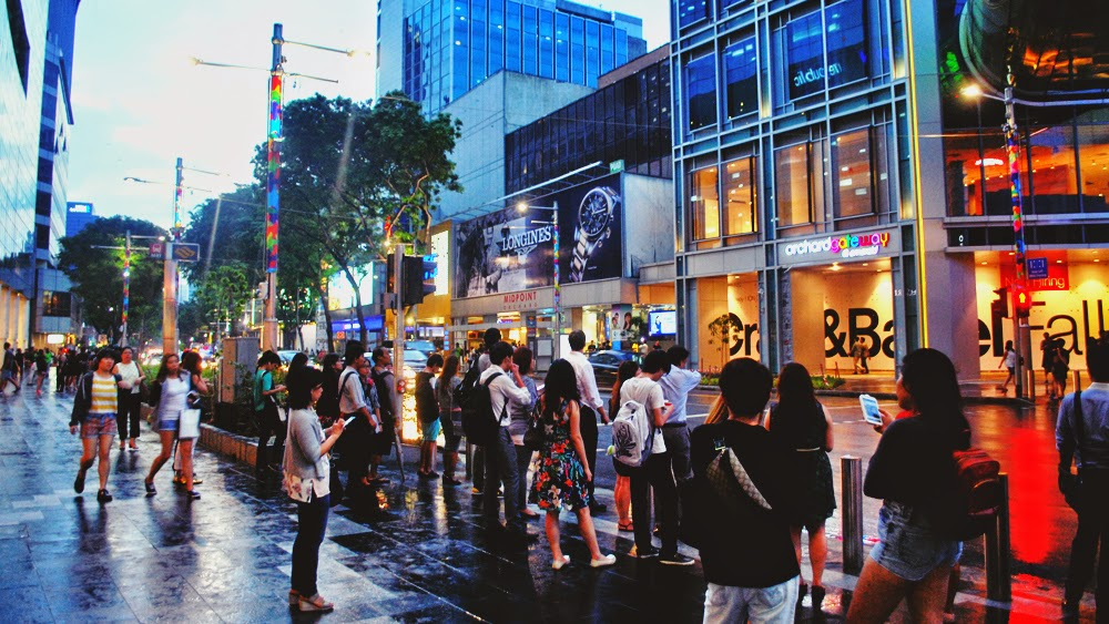 Hours after the rain, during evening rush hour at Orchard Road.
