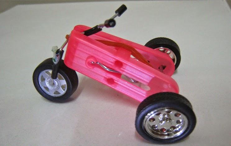 Xe đồ chơi chạy bằng dây thun