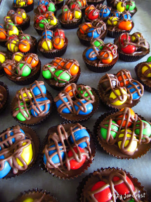 peanut butter cups with MandMs on top and chocolate