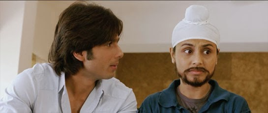 Rohan appeals to Veer for advice while Veer looks away with a comic expression.