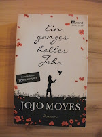 http://www.amazon.de/ganzes-halbes-Jahr-Jojo-Moyes/dp/3499267039/ref=cm_cr_pr_product_top