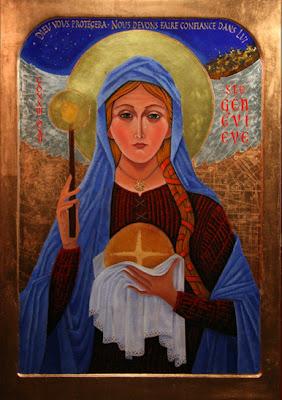 Icono de la santa con un pan en una mano y el la otra una vela encendida