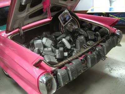 Pink Cadillac trunk full of metal radios
