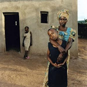 Crimes and consequences. The hugged child is her husband's daughters, the other is from a violence.