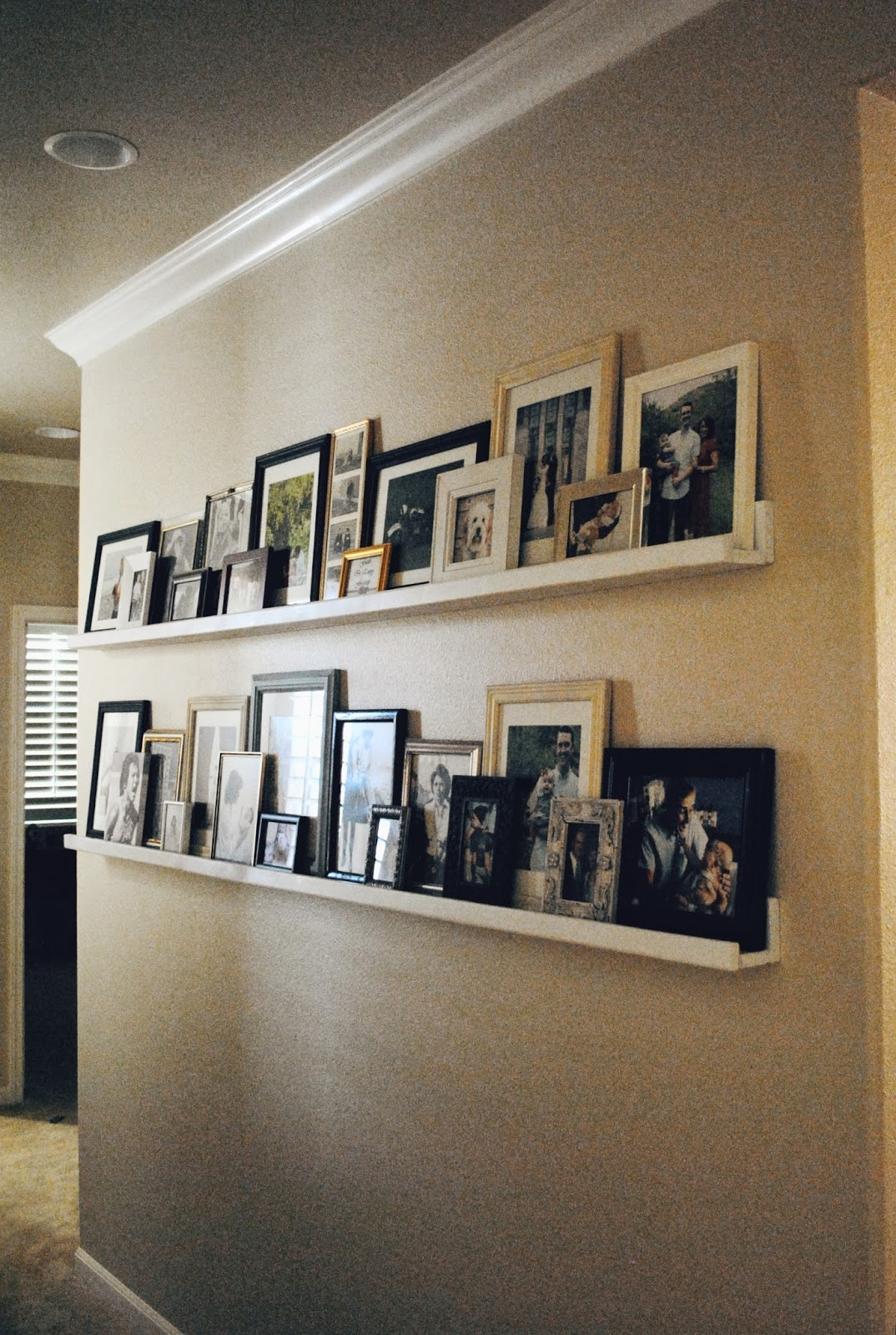 Notes from nessa diy picture ledges for Picture wall layout