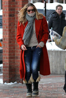 Absolutely retro in a red waiscoat, jeans, and matching boots, there is no doubt that the combination will sell like delicious cakes when the stunning brunette, Elle MacPherson, 51, was snapped walking alone at the street in Aspen, CO 81611, USA on Friday, December 18, 2015.