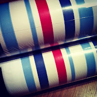 red, white and blue striped wallpaper