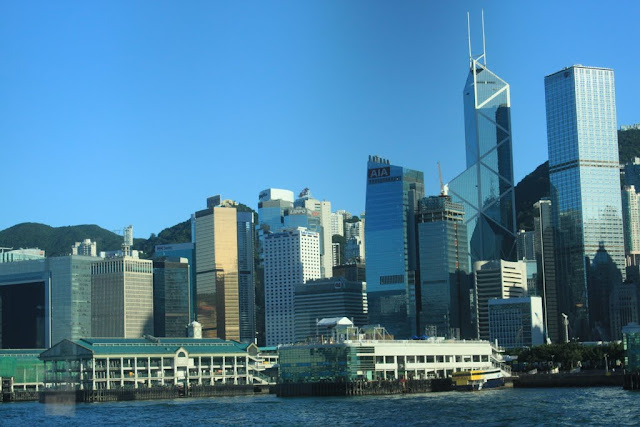 Wan Chai Pier on the Hong Kong Island and also surrounded by skyscrapers in Hong Kong