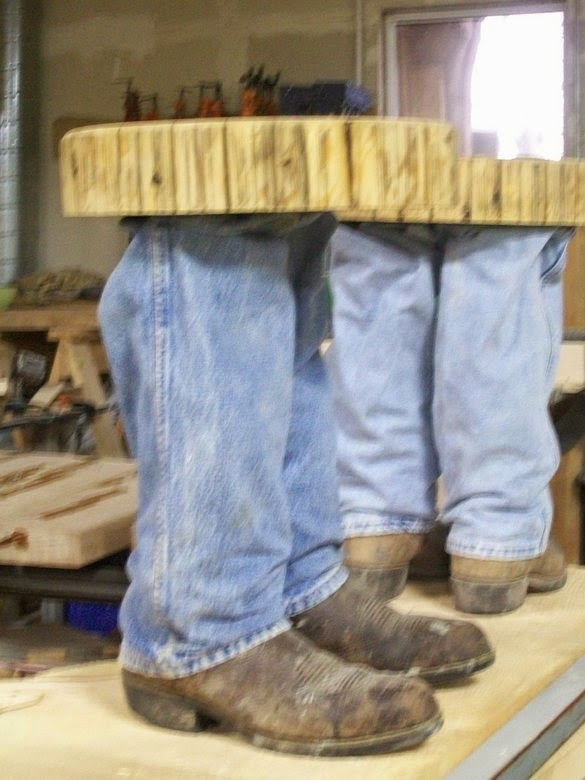 http://www.custommade.com/cowboy-boot-table/by/fbtsawmill/