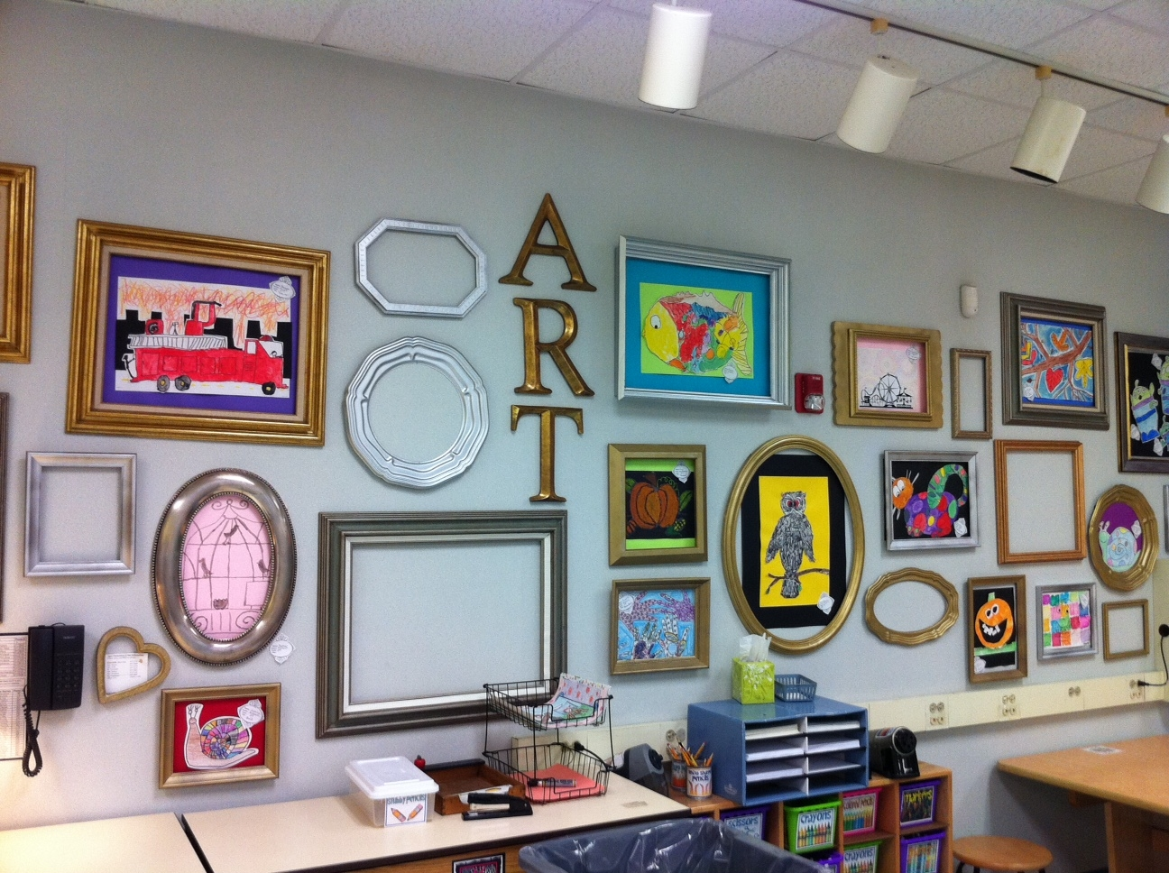 wall of frames for student artwork