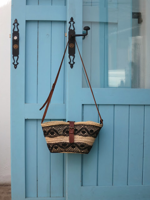 blue door and straw bag with laces
