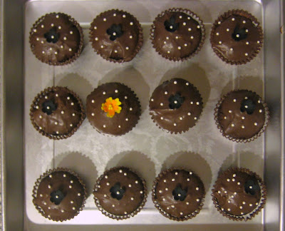 Extra Cupcakes with Black Flowers and Yellow and Orange Flower - Overhead View