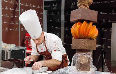 Swiss pastry chef David Pasquiet (C) prepares a chocolate creation during the 'World Chocolate Masters' contest at the Paris chocolate fair on October 28, 2013. Paris chocolate fair's 2013 edition will start from October 30 until November 3