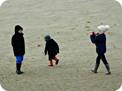 Playing on the beach in winter