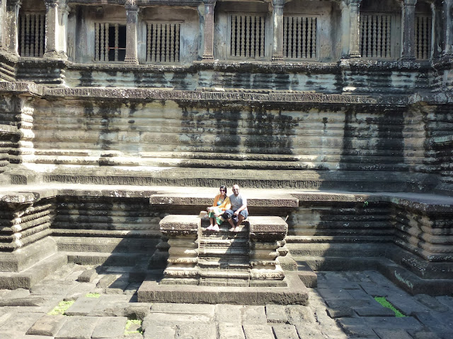 We sit at the stone ruins of Angkar Wat in Siem Reap, Cambodia