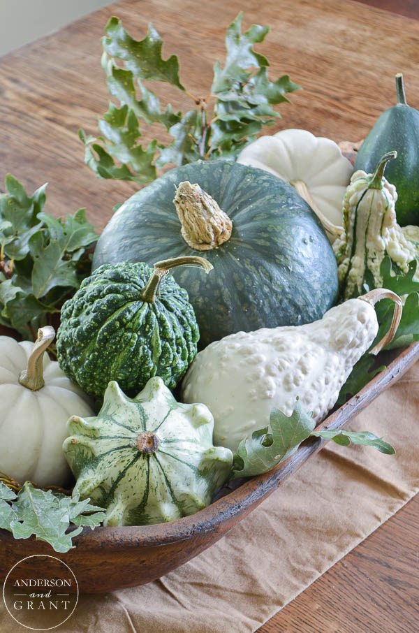Isn't this dough bowl filled with fall squash, gourds, and pumpkins beautiful for the dining room table?  |  www.andersonandgrant.com