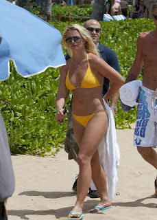 Britney Spears caught in Hawaii lounging & tanning in a yellow bikini
