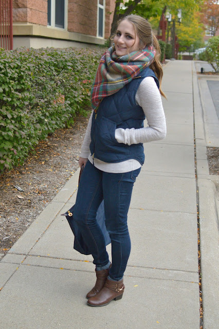 navy puffer vest with a blanket scarf