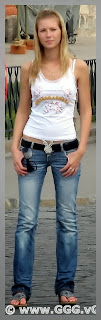 Girl wearing white shirt and low rise jeans