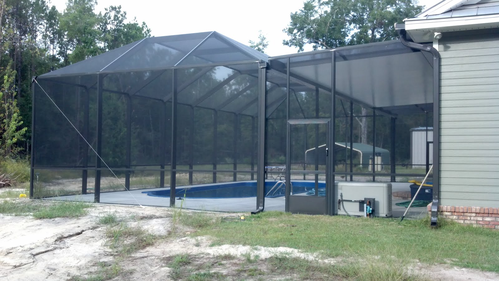 Screen rooms tallahassee pool enclosure with solid roof for Pool enclosures prices