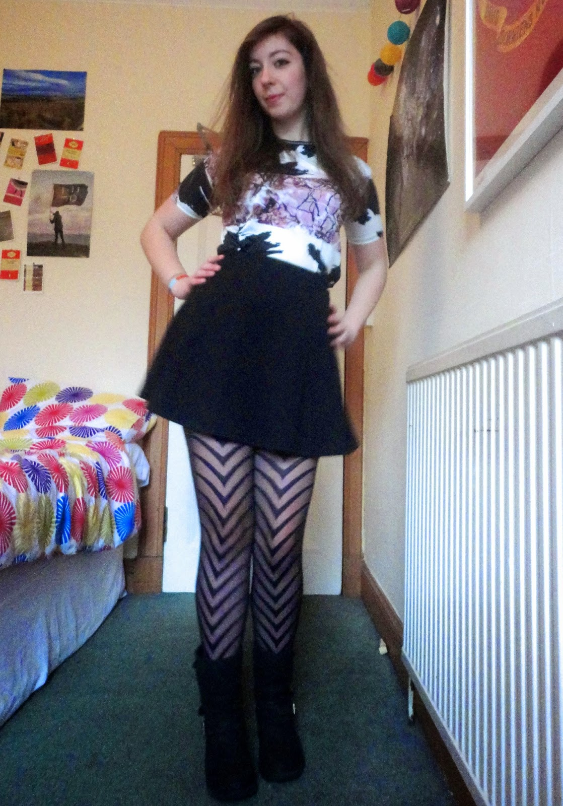 Cherry Blossom | outfit of purple floral top, black skater skirt, biker boots, geometric striped tights