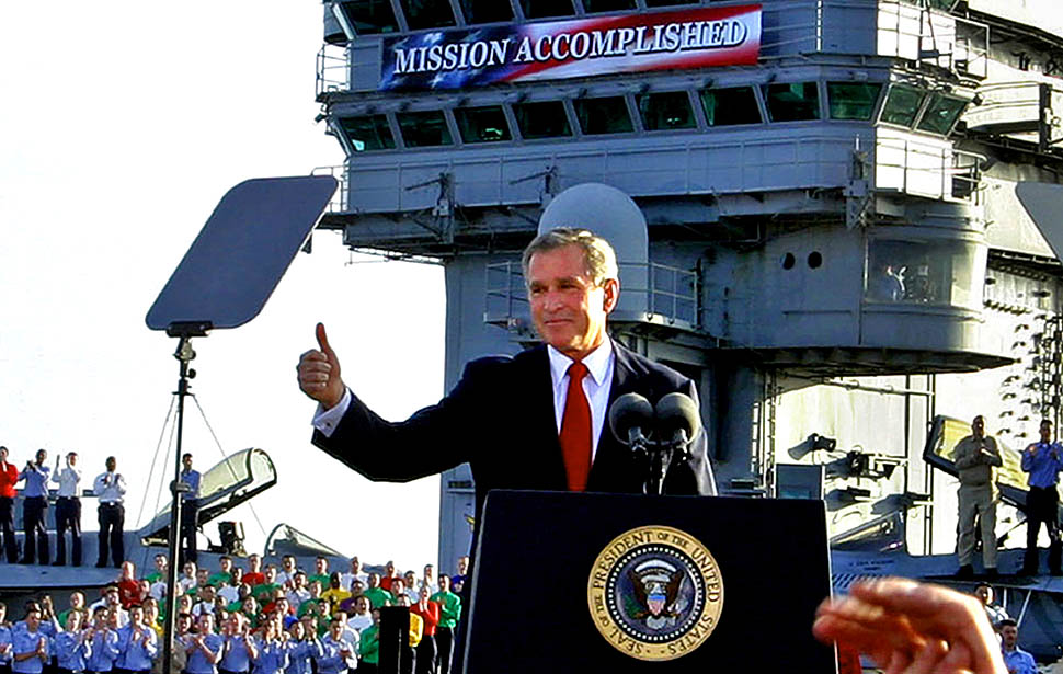 bush-mission-accomplished-iraq-thumbsup.