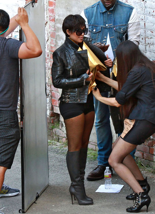 Kim Kardashian in short shorts and boots
